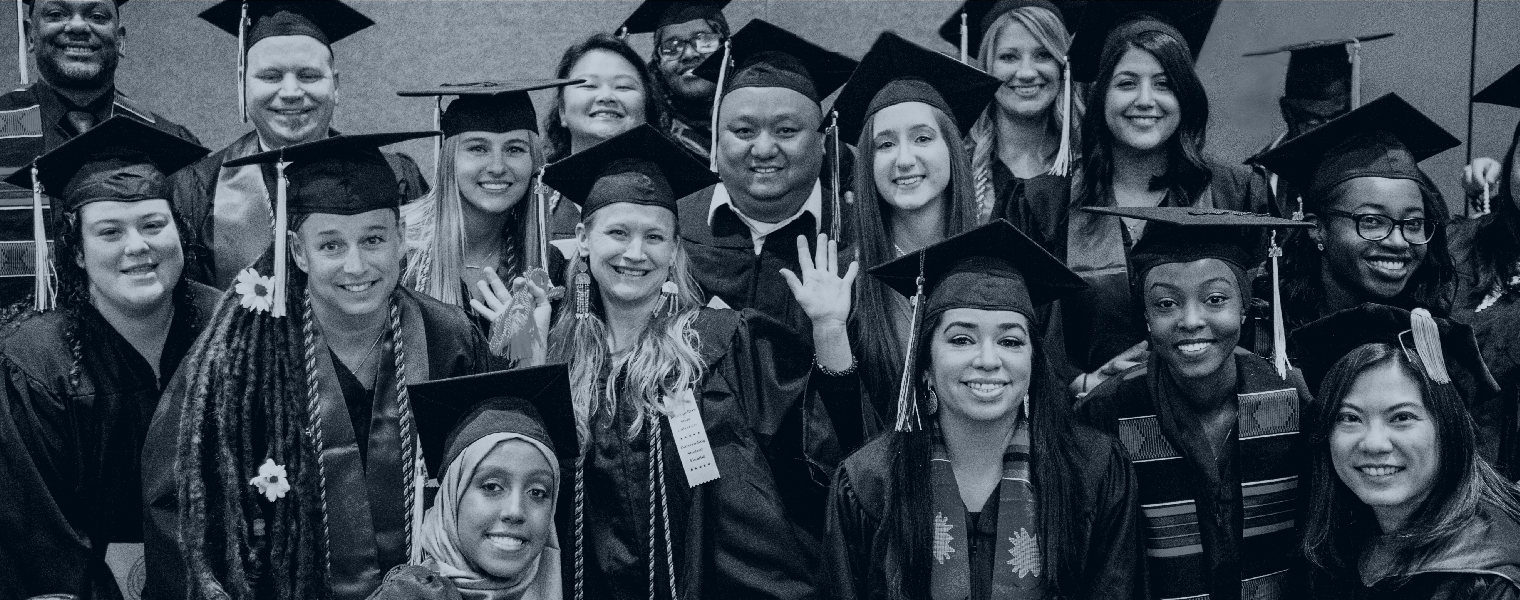 large group of happy Metro State graduates at Fall 2019 commencement