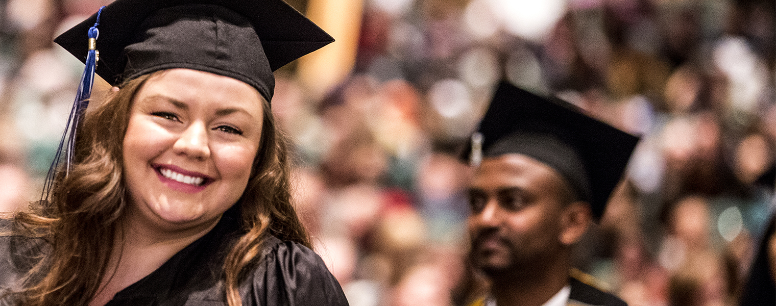 smiling female graduate at Metro State commencement