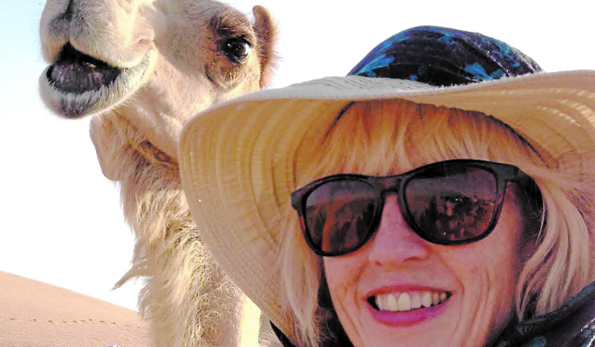 Courtesy photo Alison McGhee seems to be sharing a joke with a camel in Sharjah, United Arab Emirates, when she attended the International Reading Festival there in late April. (Courtesy photo)