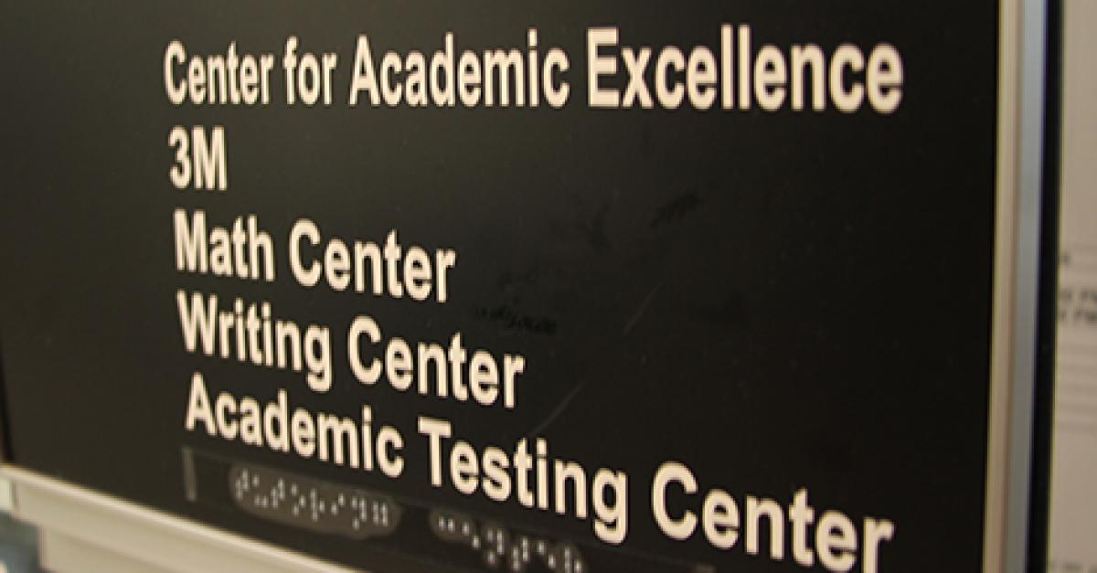 Sign for the Center for Academic Excellence, Writing Center, and Academic Testing Center.