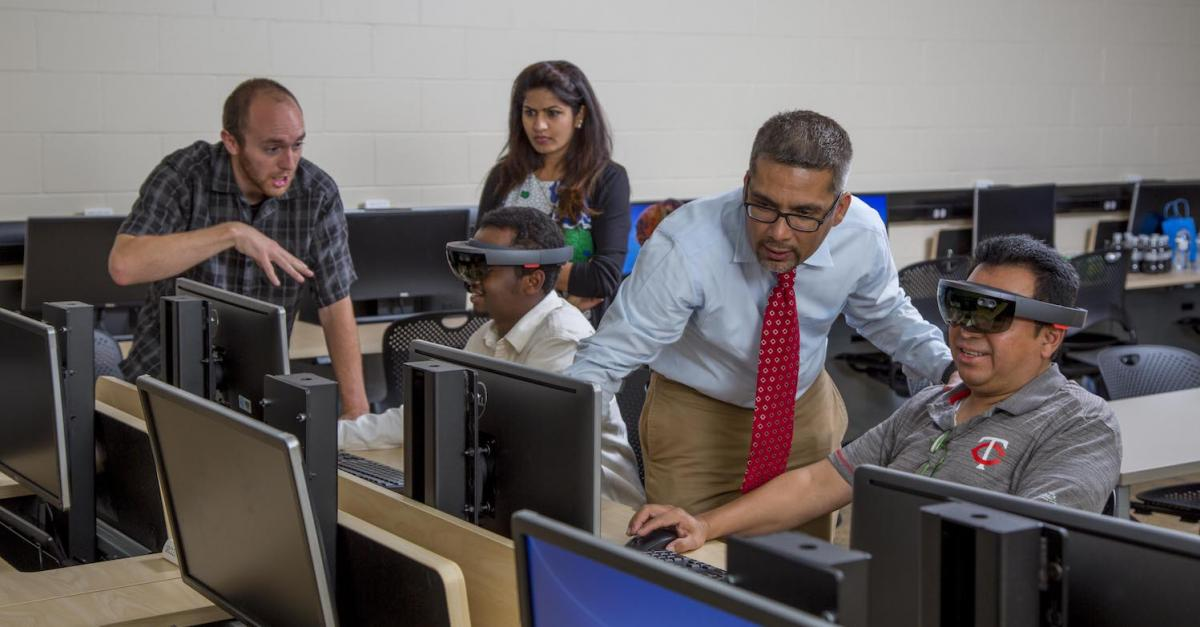 faculty and students in computer lab with virtual reality headsets