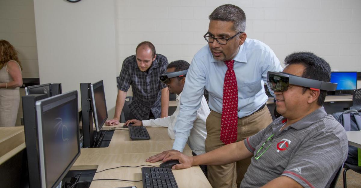 faculty and students in cybersecurity lab