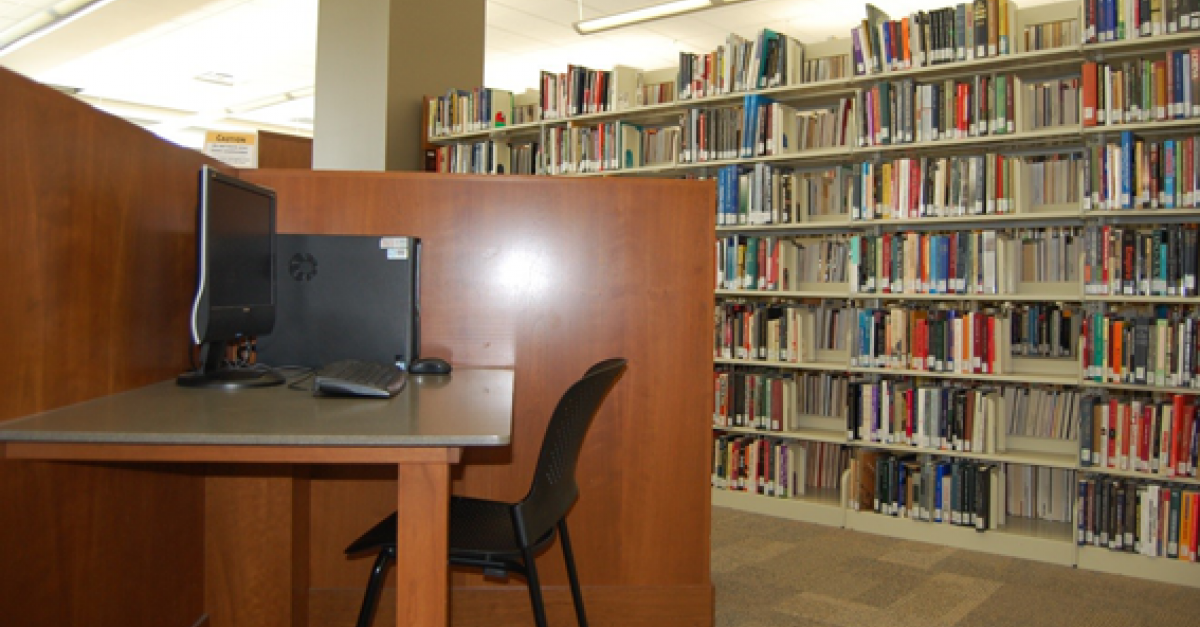 Library computer station and books